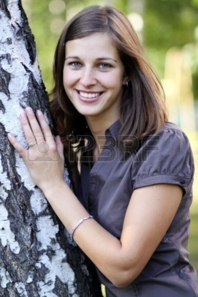 6849266-russian-beauty--the-happy-girl-at-a-white-birch