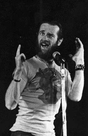 George Carlin makes a funny face.