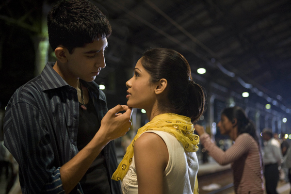 Jamal Malik (Dev Patel) and Latika (Freida Pinto).