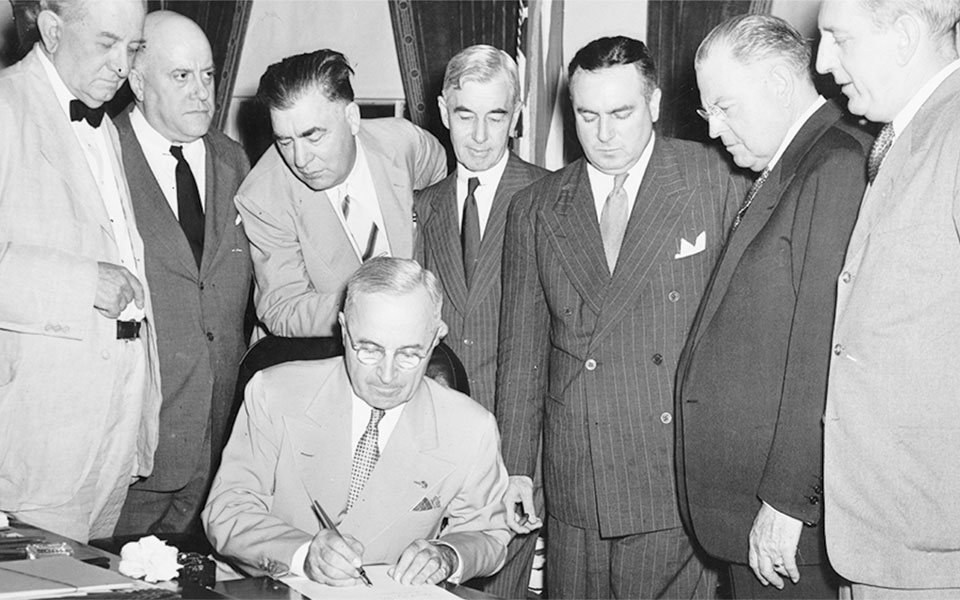 Truman signs the Atomic Energy Act of 1946 Sens Connally Millikin Johnson McMahon Austin Russell