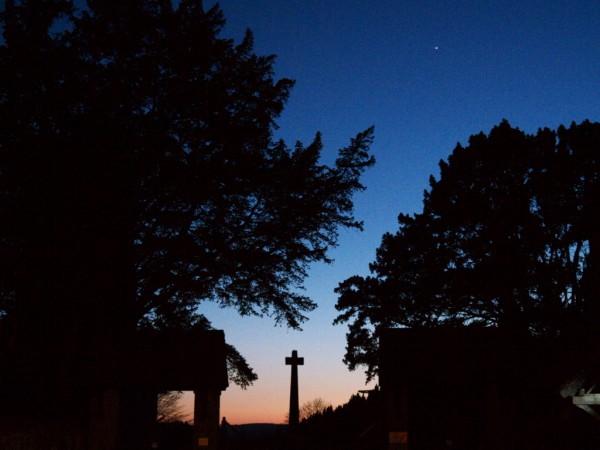 Broadclyst war memorial at dusk