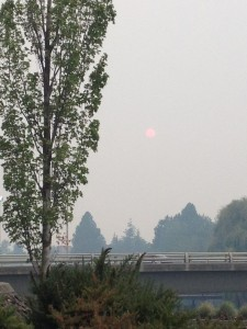 Smoky Spokane: a view from behind the convention center out over the park
