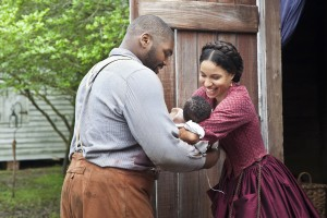 zeke-theodus-crane-holding-his-newborn-son-that-rosalee-jurnee-smollett-bell-helped-deliver