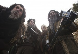 454245-people-dressed-up-as-dwarves-film-a-promotional-video-for-the-the-hobb