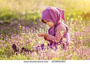 stock-photo-little-muslim-girl-praying-in-the-field-1039992907.jpg