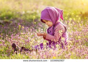 stock-photo-little-muslim-girl-praying-in-the-field-1039992907.jpg