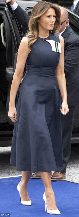 On Wednesday, Melania wore a sleeveless navy dress by Calvin Klein in Waterloo, Belgium.jpg