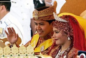 20  Brunei's Princess Majeedah Nuurul Bulqiah and her new husband, Khairul Khalil, 32, greet onlookers Sunday during a procession after their wedding…
