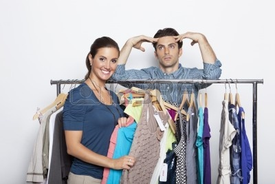 8  8426652-portrait-of-smiling-young-woman-selecting-clothes-with-bored-guy-at-clothing-store.jpg