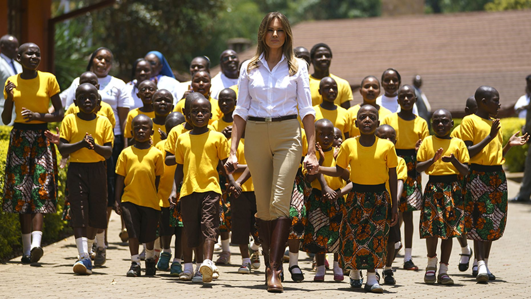 Day 5 First lady Melania Trump walks with singing children as she visits the Nest Orphanage in Limuru, Kenya, Friday, Oct. 5 (AP).jpg