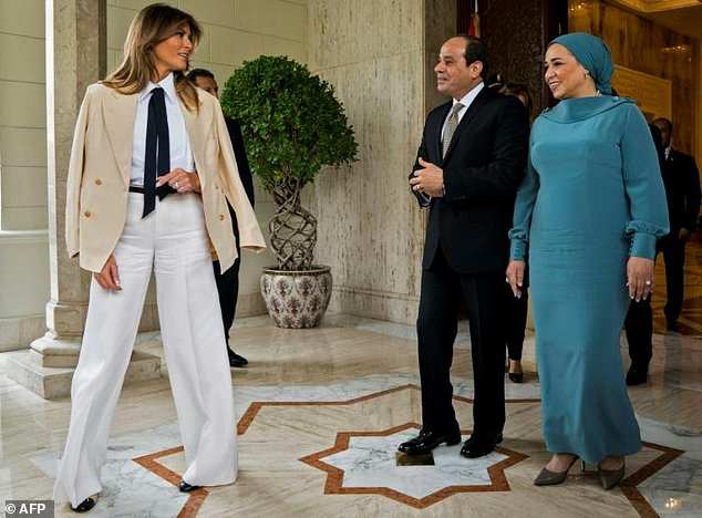 Day 6 US First Lady Melania Trump (L) is welcomed by Egyptian President Abdel Fattah al-Sisi (C) and his wife Intissar Amer (R) upon arrival at the P…