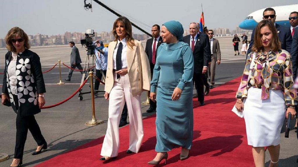 Day 6 US First Lady Melania Trump walks with her Egyptian counterpart Intissar Amer al-Sisi after arriving at Cairo International Airport.jpg