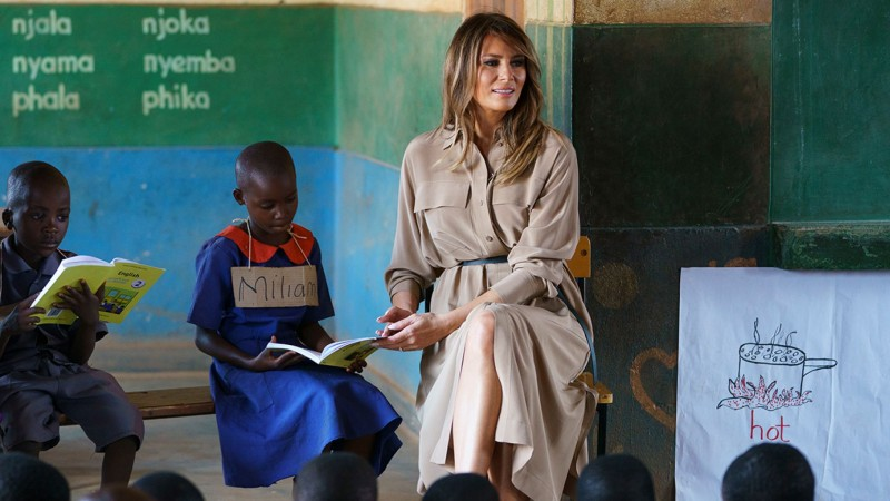 Day 4 First lady Melania Trump helps a student as she visits a language class at Chipala Primary School, in Lilongwe, Malawi, Thursday, Oct. 4 (AP).j…