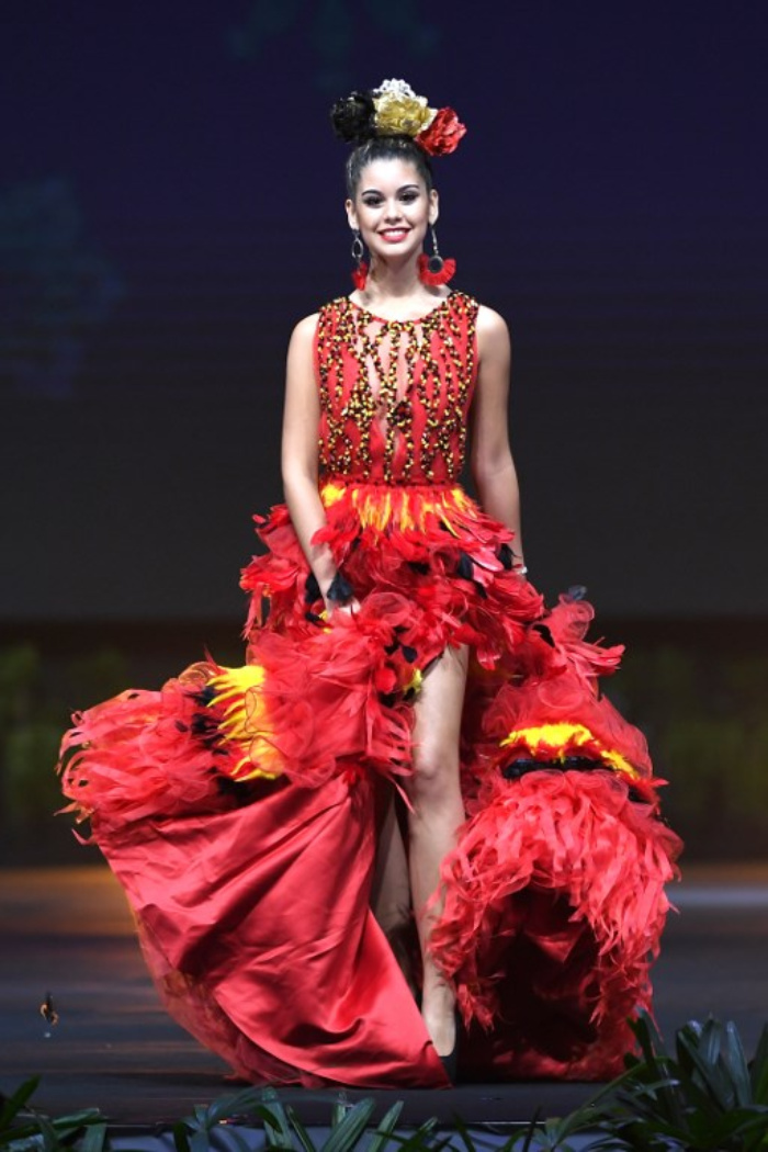 Belgium this designer dress is made out of tissues and feathers that form the three Belgian colors  yellow, red and black,  ornamented by two pounds …