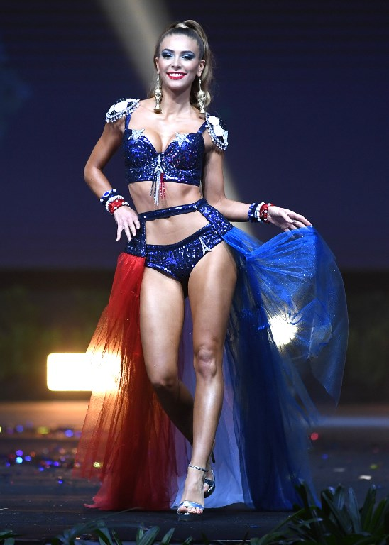 France red, white and blue flag colors, in bikini as shout out to Corsica, decorated by emblems of the World Cup trophy.jpg