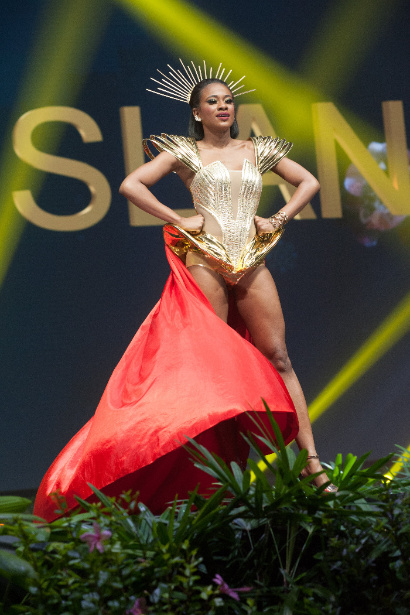 US Virgin Islands inspired by the phoenix and Queen Mary's reimagined gown in gold corset with jewels..jpg