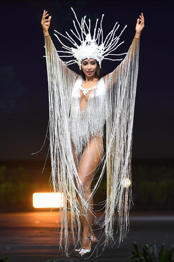 Bolivia Inspired by world's biggest salt flat; the headdress represents the crystallization of salt..jpg