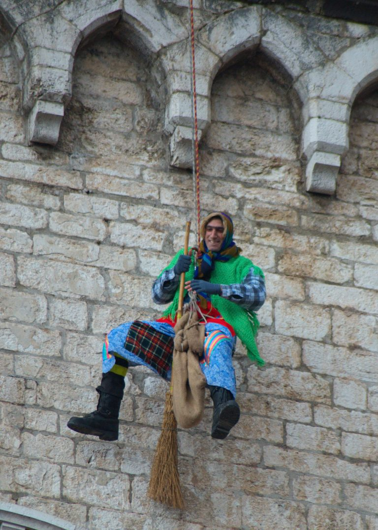 15 An Italian firefighter dressed up as the Befana descends from Gubbio's medieval buildings..jpg