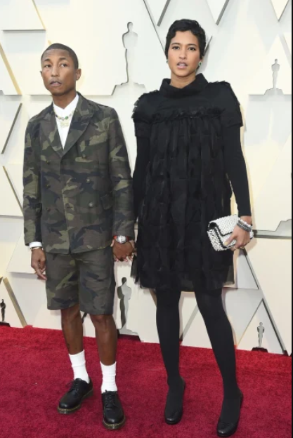Pharrell Williams, left, and Helen Lasichanh.PNG