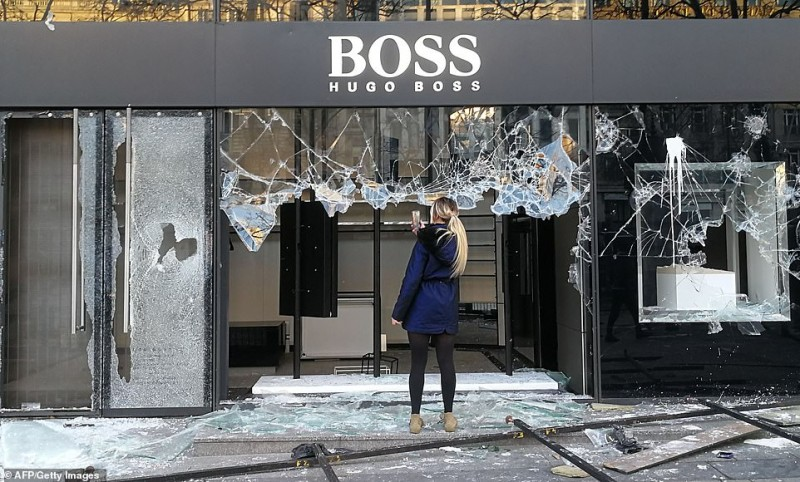 1  11080538-6816815-A_woman_stands_on_broken_glass_to_take_a_quick_picture_of_the_wr-m-21_1552759013877.jpg