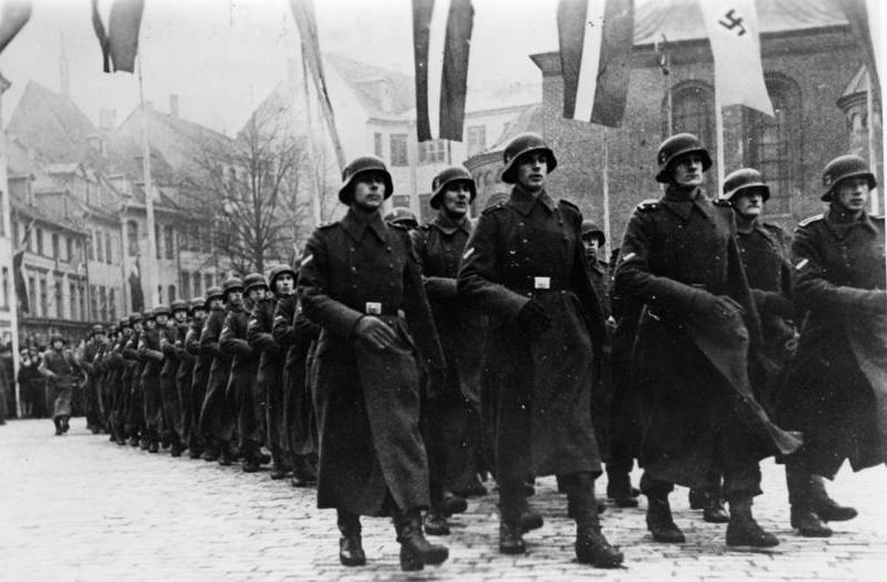2 Latvian SS-Legion marching next to Dome Cathedral in Riga on Latvian Independence Day, 1943.jpg