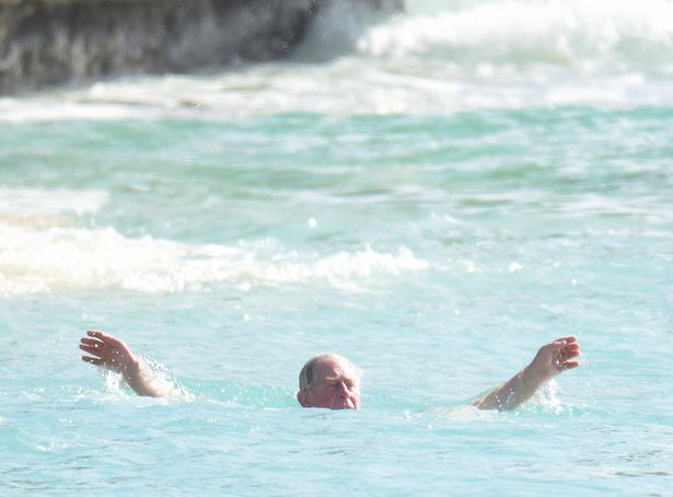 1_PAY-EXCLUSIVE-Prince-Charles-in-natty-floral-swim-trunks-on-the-beach-in-Barbados (2).jpg