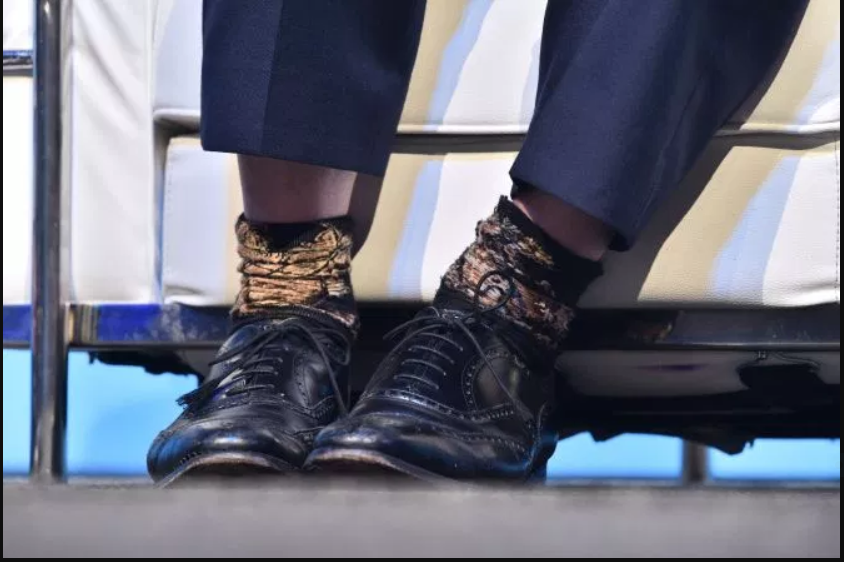 2  Saturday Boris Johnson was seen wearing the distinctive socks in Birmingham, with one looking inside out.PNG