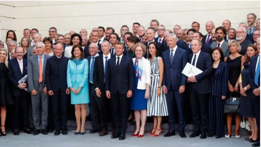 French President Emmanuel Macron, center, poses with G7-Summit civil society representatives, including Kering chairman and CEO François-Henri Pinaul…