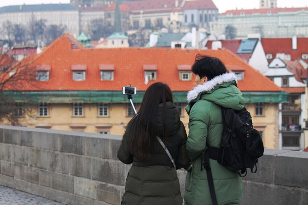 man-and-woman-using-a-selfie-stick.jpg