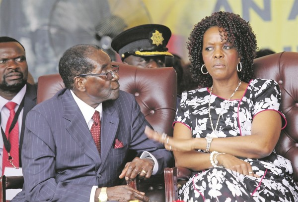 1    President-Robert-Mugabe-sits-with-his-wife-Grace-PHOTO-AP.jpg