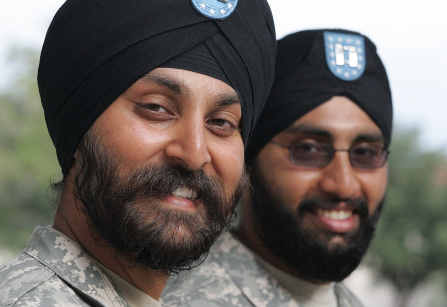 1 Army Lt. Col. Kamal Kalsi; left; and now-Maj. Tejdeep Rattan were the first two Sikh soldiers to receive an exemption to serve in their religiously…