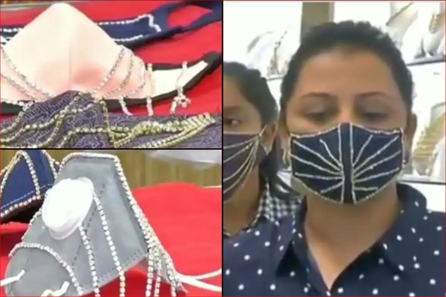 5 0  Diamond-studded face masks at a Surat store.PNG