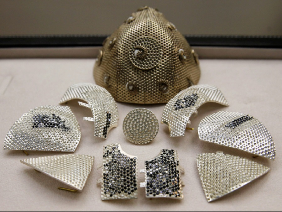 20 Parts of a diamond encrusted gold coronavirus disease face mask, is seen in a fine jewelry factory in Motza, Israel.jpg