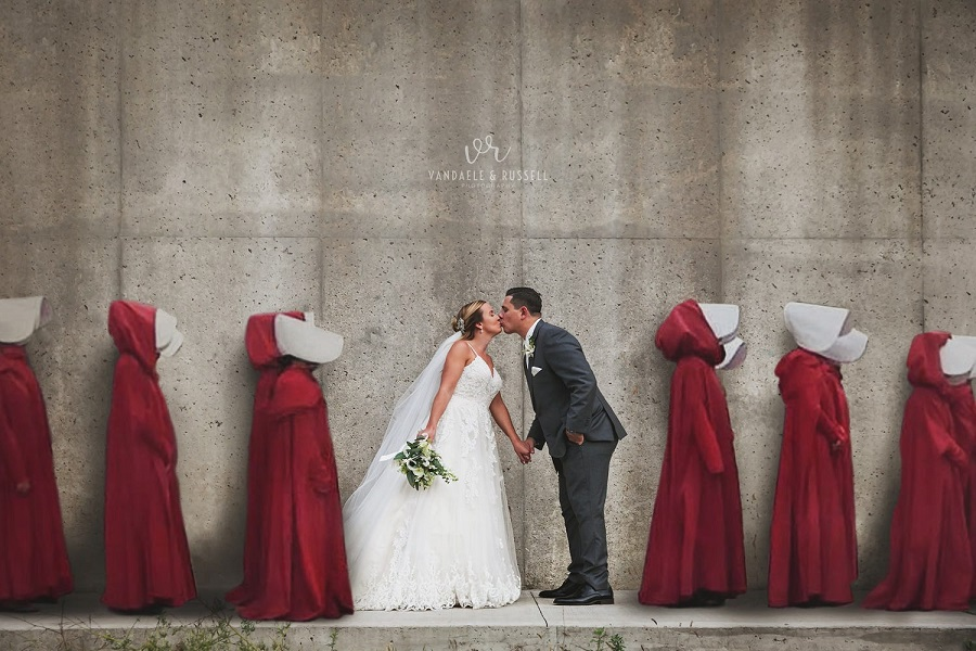 _900 x 600 A couple pose for a wedding photo inspired by The Handmaids Tale.2019.jpg
