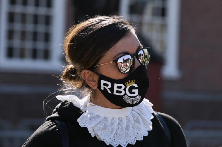 A woman dressed as Justice Ruth Bader Ginsburg participates in a Women's March as part of a nationwide protest against President Donald Trump's Supre…