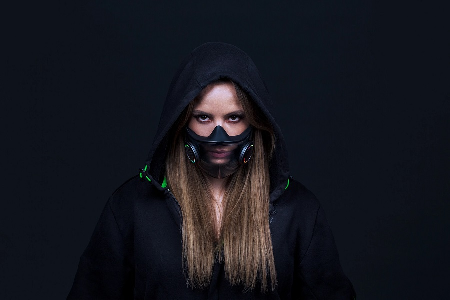 The mask is transparent, allowing the wearer's mouth movements to be visible.jpg