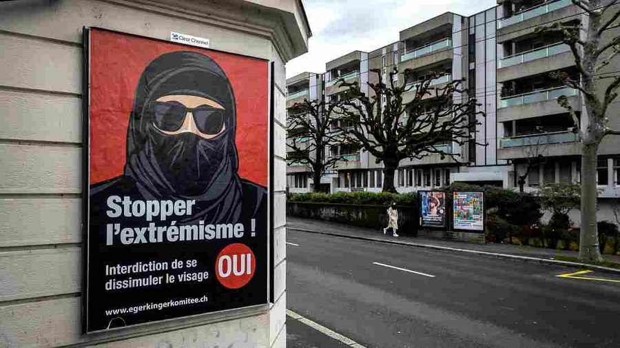 1 A poster in Lausanne, Switzerland, reads Stop extremism! The Swiss passed a new ban on facial coverings in public in a narrow 51.2% majority vote S…