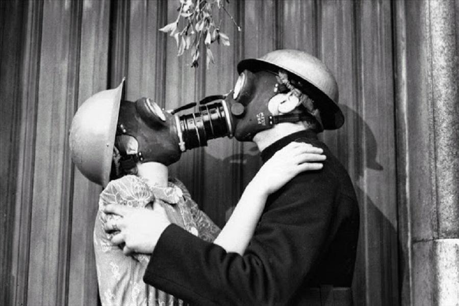 1  A couple wearing gas masks kisses under mistletoe, London, December 1940..jpg