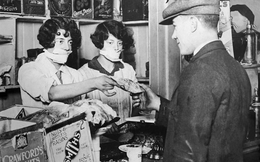 4  Saleswomen in London wearing masks in the 1930s, to protect against flu.jpg