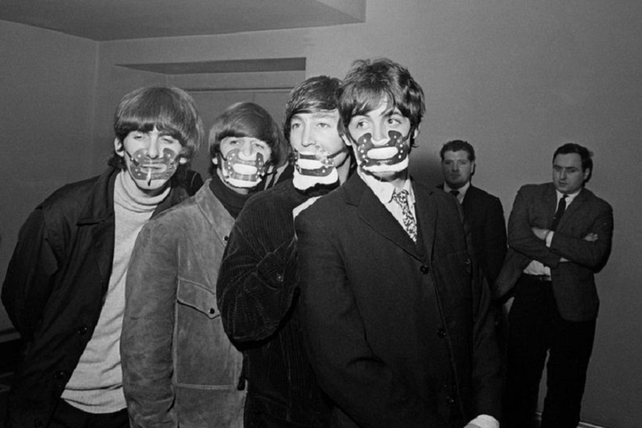 4 The Beatles with smog masks on before playing at the Ardwick Theare, December 7, 1965.jpg
