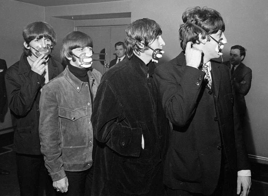he Beatles with smog masks on before playing at the Ardwick Theare, Manchester. 7th December 1965..jpg