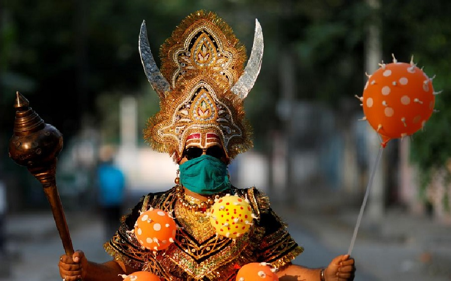 1  A man dressed as Yamraj, the Hindu god of death, in a coronavirus-themed costume in New Delhi.8.jpg