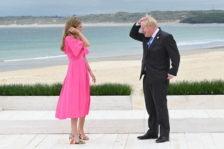 3 Prime Minister Boris Johnson and Carrie Johnson wait to greet guests for the leaders official welcome and family photo, during the G7 summit in Cor…