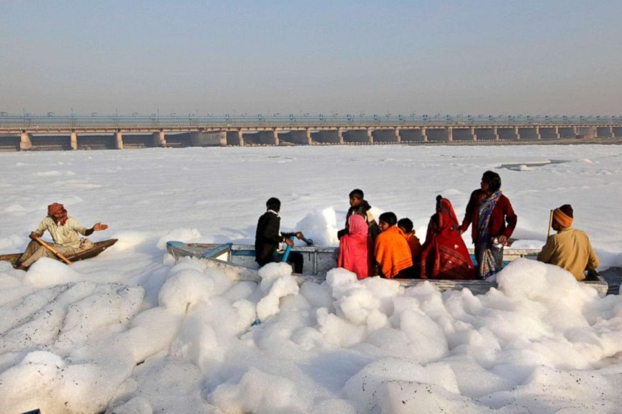 _900 x 600 Hindu devotees cross the Yamuna river, surrounded by industrial effluent, on a boat during Karth.jpg