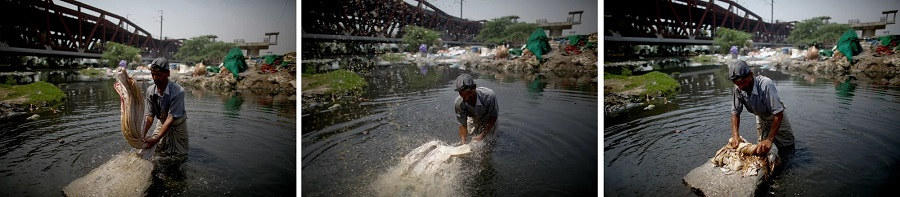 2  Mohammad Zamir, 38, washes pieces of cloth on the banks of the Yamuna River. He stands in the toxic water from 6.jpg