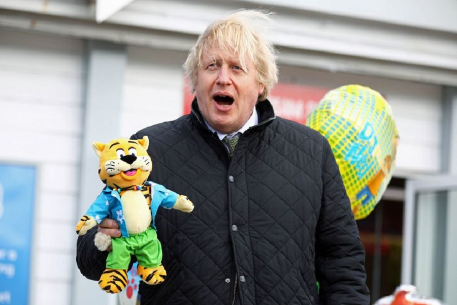 11 Prime Minister Boris Johnson holding a toy tiger during a visit to Haven Perran Sands Holiday Park.jpg