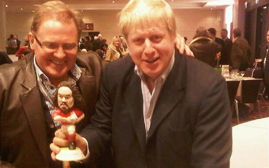 13  Boris Johnson is delighted with Adam Jones's kind gift of a signed figurine.jpg