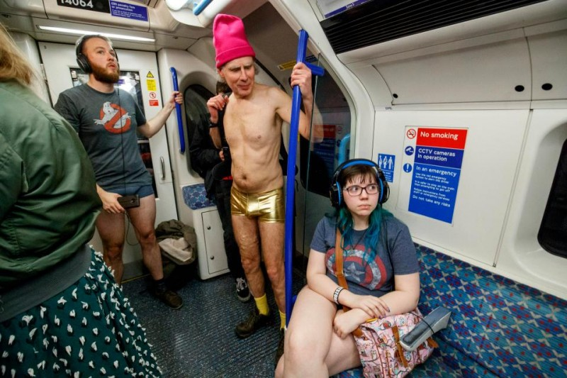 16      This commuter seems bemused at this man's golden underwear choice.jpg