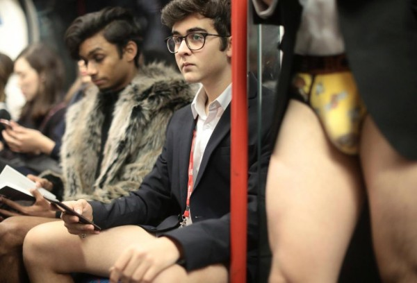 32  This straight-faced young man without trousers donned a suit jacket and a shirt on the tube.jpg