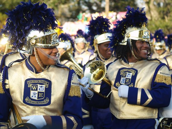 26  High school marching bands bring a big brass beat to the Carnival parade route..jpg